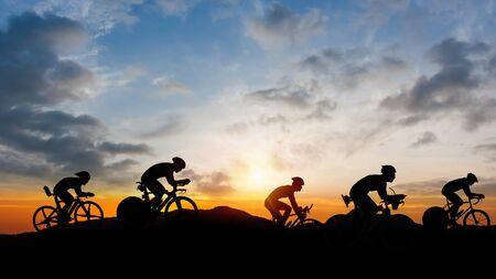 Cycling triathlon on mountain twilight time Stok Fotoğraf