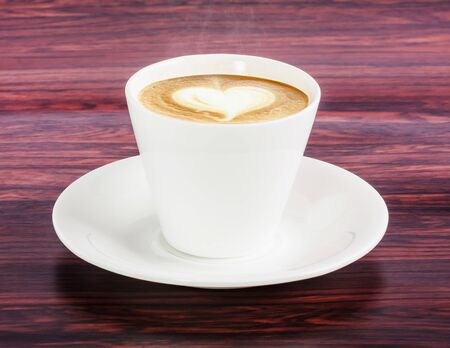 Coffee white cup on wooden table