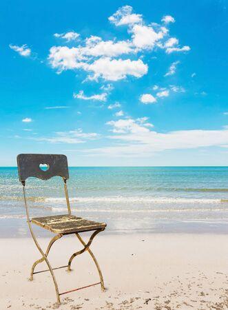 Chair love at beach on daylight