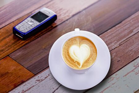 Coffee love cup with mobile phone vintage style