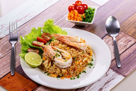 Shrimp fried rice on wooden table