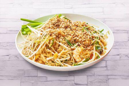 Pad thai food with shrimp on table