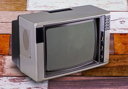 Television vintage style isolated on wooden background