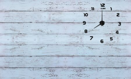 Clock on old wooden background vintage style