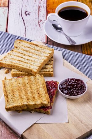 Bread with mixed berry on wooden table