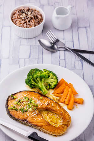 Salmon steak with teriyaki sauce on white plate Reklamní fotografie