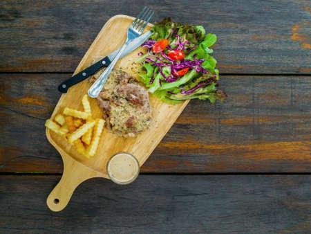Pork steak with vegetables tasty food on wooden plate