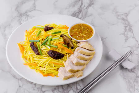 Fried vegetarian shou noodles Asia cuisine on marble background