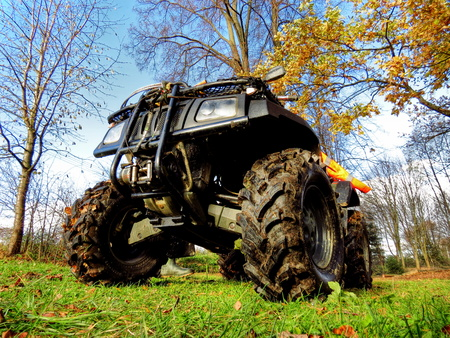 dirt road recreation: Big ATV parking in the forest, big wheels Stock Photo
