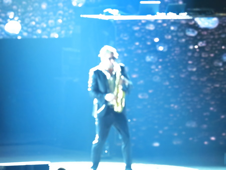 the blurred Concert guy with the saxophone