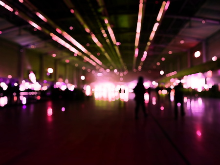 Dark Abstract blurry people in exhibition event hall