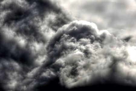 Dark ominous grey storm clouds. Dramatic sky. Stock Photo