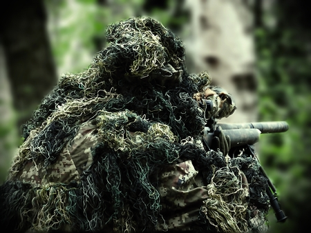 robustness: painted airsoft player with Ghillie Suit and sniper rifle