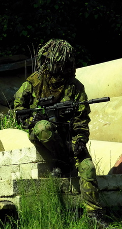 robustness: airsoft boy with m4a1 carbine, camouflage model 95 (vz95) czech republic Stock Photo
