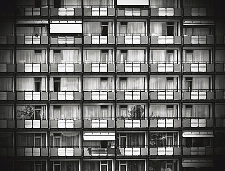 dreary: vintage black and white residential concept - dreary grey and blue prefabshousing Stock Photo