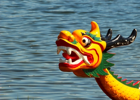 dragonboat: Dragon head on the dragonboat on the watter background Stock Photo