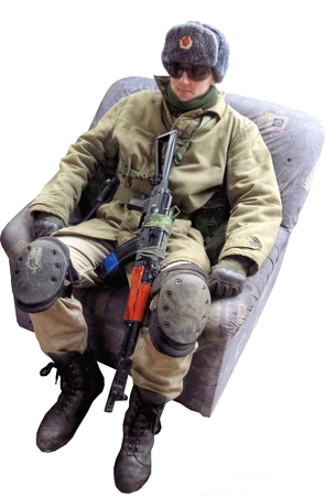 uniform airsoft player, who plays for Russian side of the army, isolate in the white blackground