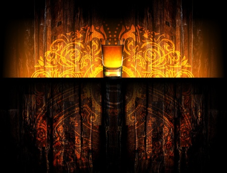 alcohol drink on the wood background, light ornament on the wall