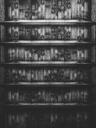 Empty dark wooden shelf, black and white, horror atmosphere, suitable as a background 写真素材