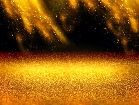 Abstract gold background with floating and reflecting gold dust