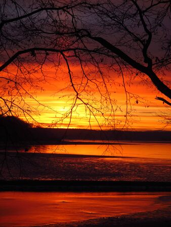 Romantic situation at pond, amazingly red sunset over pond
