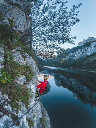 Via Ferrata Laserer alpin Klettersteig at lake gosausee under Dachstein mountain