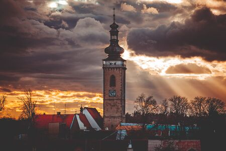 the dramatic sky and in the middle of the tower, clouds shining through the sun Stock fotó