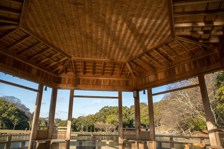 classical hexagonal wooden pavilion appears to float on Sagiie Pond. 스톡 콘텐츠