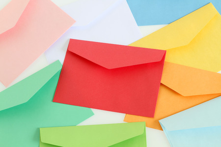 Red envelope on the colorful envelopes photo