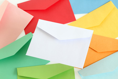 White envelope on the colorful envelopes photo