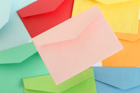 Pink envelope on the colorful envelopes photo