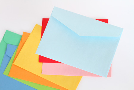 Light blue envelope on the colorful envelopes photo