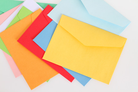Yellow envelope on the colorful envelopes photo