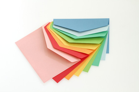 Colorful envelopes on white background photo