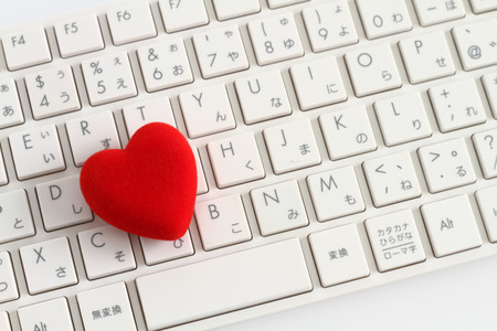 Red heart on white keyboard
