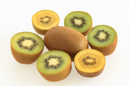 Green Kiwi and Gold Kiwi on white background Stock Photo