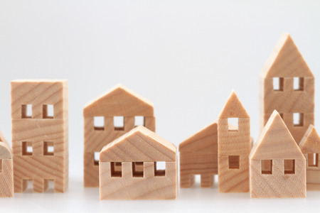 house construction: Miniature house on white background