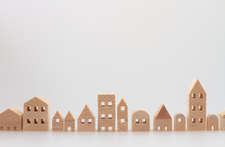 row: Miniature house on white background