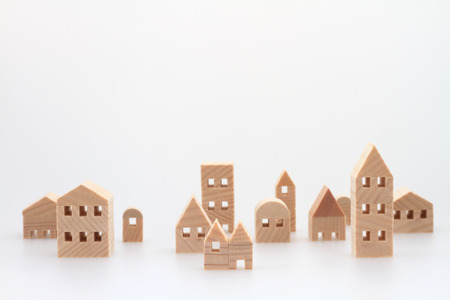 town homes: Miniature house on white background