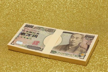 MILLION: Stack of one million yen bills on gold background