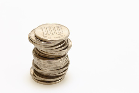 Pile of Japanese coins on white background