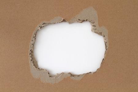 white hole: White hole in cardboard Stock Photo