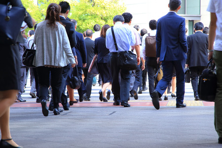 Japanese business people walking at rush hour Stock Photo