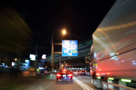 truck driver: Truck driving on highway at night Stock Photo
