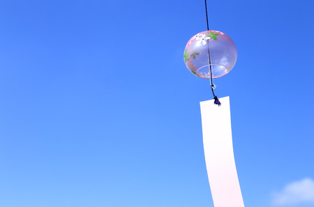 Japanese wind chime against blue sky Stock Photo - 90273336
