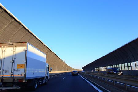 Truck transportation on highway Фото со стока