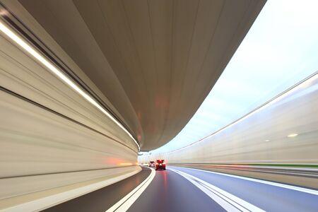Car driving through the tunnel