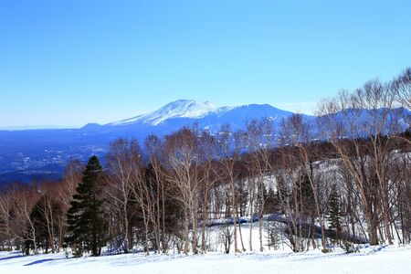 Winter landscape in ski resort with Mount Asama