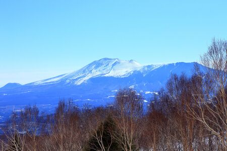 Snow covered Mount Asama view from ski resort 写真素材