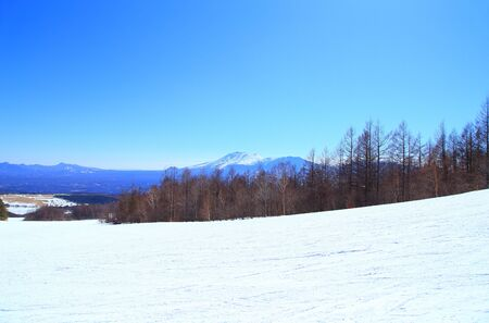 Winter landscape in ski resort with Mount Asama